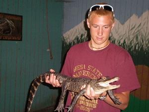 holding-baby-alligator